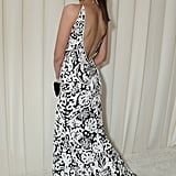 Nina Dobrev showed off the back of her dress at Elton John's Oscar party.