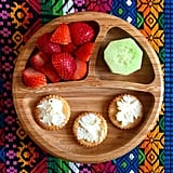 """""""Morning snack: crackers with cream cheese, strawberries, and a cucumber."""""""