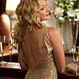 Backless, sequinned, and a glass of Champagne nearby — it's quintessential Samantha Jones.
