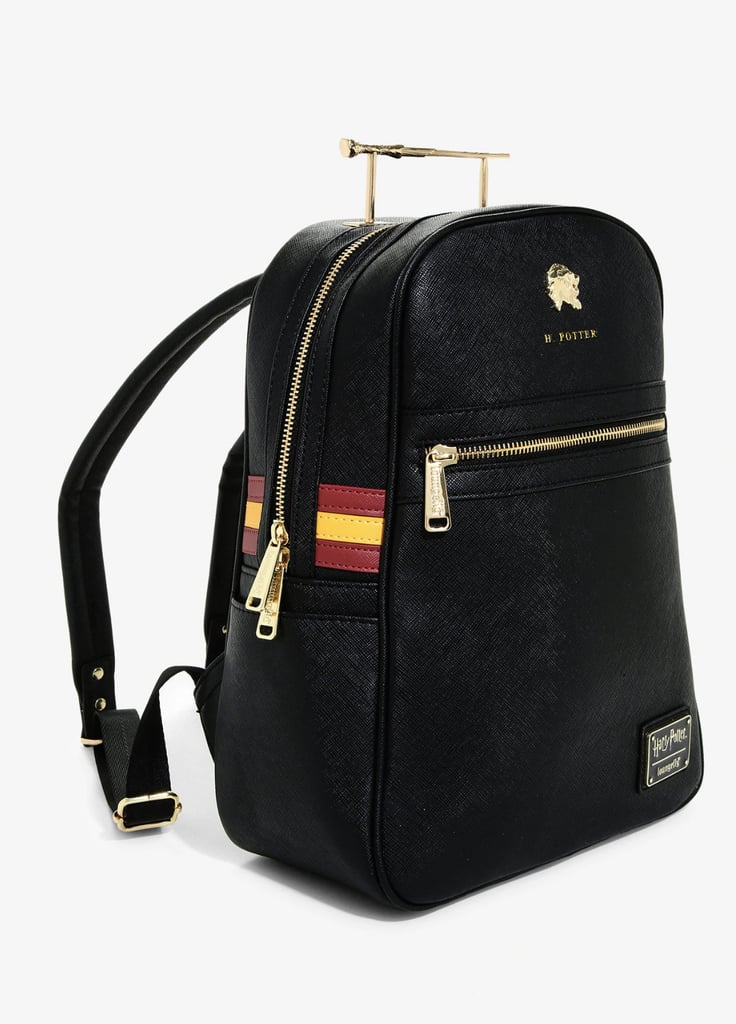 All wizards (and maybe even some muggles) know September means it's time to head back to Hogwarts, and this backpack featuring Harry Potter's wand might just be the key to receiving an acceptance letter once and for all. The stylish bag, made with artificial leather, features gold zippers, a gold lion badge, and red and yellow stripes on the sides. But it looks like someone was having a little too much fun with the reducio charm, because the biggest nod to Gryffindor house is definitely the shrunken version of Harry Potter's wand in place of a handle. As Ron would say: brilliant! The Loungefly Harry Potter Harry Wand Mini Backpack ($80) also comes with two zip compartments and two side pockets and stands at 13-inches-tall and 10-inches-wide, making it just the right size for a day trip to see the Quidditch World Cup. But if you need more space, you can always cast an undetectable extension charm on the bag. Only, instead of healing potions and books about the Dark Arts, I'm going to use it to carry an endless supply of snacks and all of my new favorite thriller novels. Take a closer look at the magical backpack ahead.      Related:                                                                                                           Pottery Barn's Fantastic Beasts Collection Looks Like It Was Created by Newt Scamander Himself