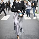 Hack: Embellished collars help you pull off the schoolgirl vibe, so tuck your top into a fluted skirt that alludes to the look but feels grown-up.