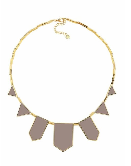 The deco-inspired piece that expertly blends polish and coolness.   House of Harlow 1960 Gold-Plated Khaki Leather Five Stations Necklace ($79)