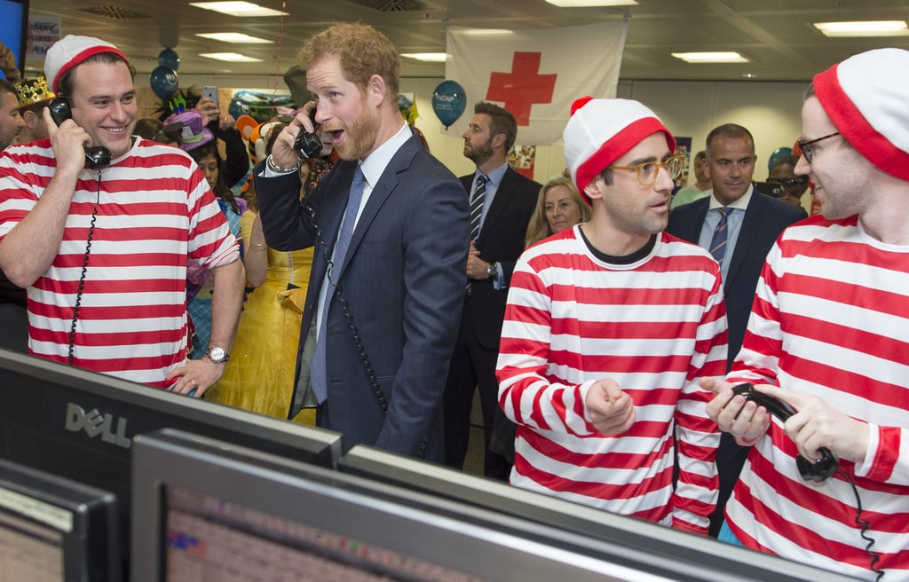 After making a pit stop in Canada to visit his girlfriend, Meghan Markle, on his way home from the Caribbean earlier this week, Prince Harry headed back to London to attend the ICAP Charity Trading Day on Wednesday. The event, which the employees wear costumes for, sees the global brokerage firm donate a day's revenue and commissions to charity. The famous royal looked extremely handsome in a dark blue suit and tie as he participated in an array of activities, including playing a game of operation and answering telephones with men dressed as Waldo from Where's Waldo? But the best part of the day was definitely Harry's hilarious facial expressions.  The fun outing comes just on the heels of Harry's 14-day tour of the Caribbean. Aside from making us melt with his numerous play dates with kids, he also made worlds collide when he met pop princess Rihanna in Barbados. Hopefully there will be even more sweet appearances from the prince as the royal family starts planning for the holidays.       Related:                                                                The Best Pictures of Prince Harry in 2016                                                                   23 Pictures of the Royals Laughing That Will Make You Spit Out Your Tea