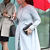 In fact, the duchess wore it when she stepped out for a visit to Kings College. She paired it with another Séraphine piece, the Natasha coat ($259), and accessorized her outfit with suede Jimmy Choo pumps, sapphire earrings, and a black quilted Jaeger clutch.