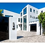 What's a Beverly Hills home without gated entry and a lengthy driveway?