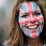 A woman wore Union Jack face-paint.