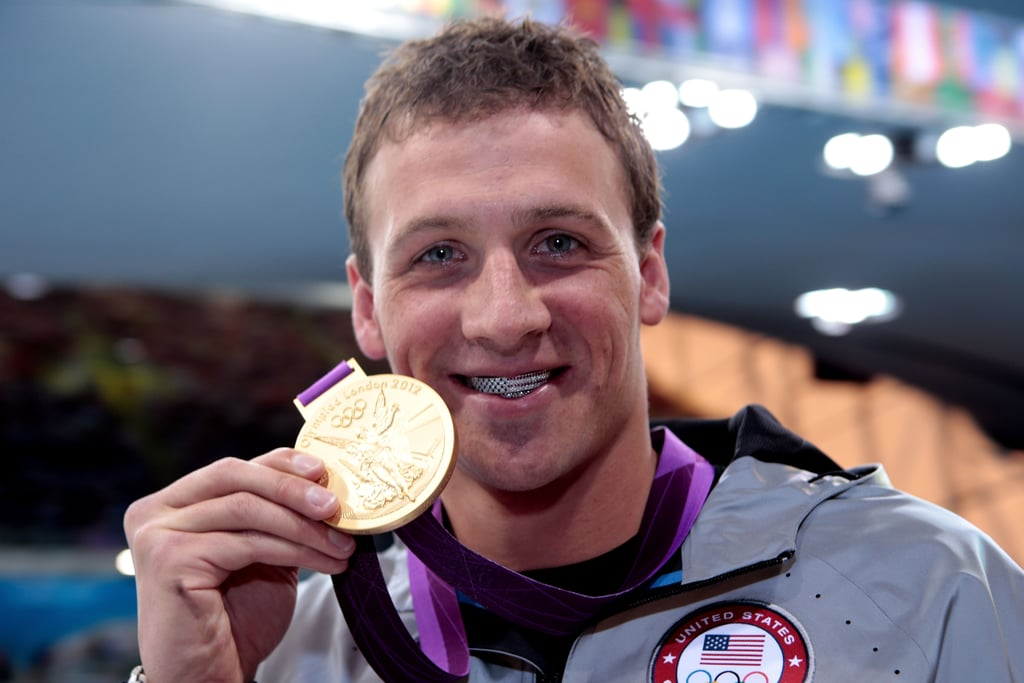 Bringing home Team USA's first gold medal, Ryan Lochte couldn't help but flash his grill.