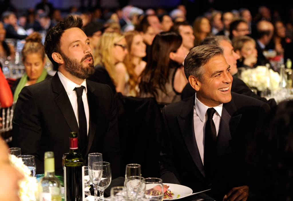 George Clooney didn't walk the red carpet, but he did attend the 2013 Critics' Choice Awards in LA on Thursday night. The actor was spotted wearing a classic suit and sitting at friend Ben Affleck's table at the show, laughing along to Rebel Wilson's jokes as she presented Judd Apatow with an award. George also chatted with Eva Longoria during a commercial break. The actor wasn't up for any awards, but it looked like he wanted to support his fellow Hollywood stars at the event. If you want more award-show fashion, then be sure to check out our red-carpet polls. Also, don't forget to vote in our Golden Globes winner predictions ballot before the show airs on Sunday.