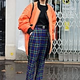 Dress Up Your Plaid Pants With a Stark White Pair of Boots