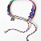 This slender friendship bracelet boasts a cute color combo.  Lucy Folk Silver Royal Friendship Band ($117)