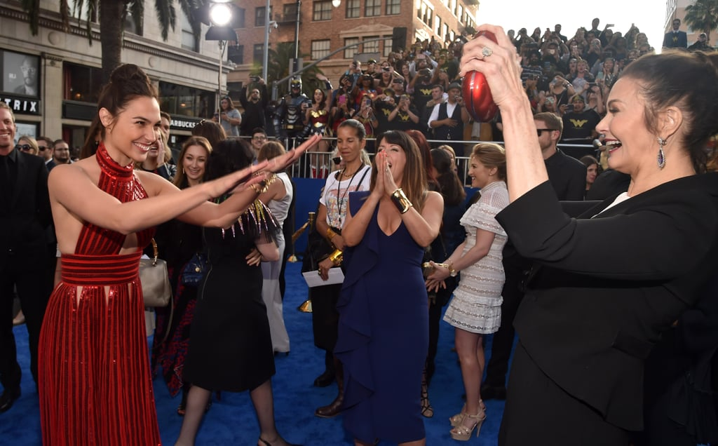 "You might have expected Thursday night's Wonder Woman premiere in Hollywood to be all about the exciting movie inside, but the best moment of the event actually happened outside on the red (blue?) carpet. The superhero flick's star, Gal Gadot, paid homage to the OG Wonder Woman, Lynda Carter, in the cutest way when they bumped into each other. As soon as Gal spotted Lynda, she began ""worshipping"" her hero, and the two — who attended the Wonder Woman UN Conference together back in October — happily hugged and smiled for photographers. Director Patty Jenkins (seen in the blue gown) had a reaction to their adorable reunion that says it all.      Related:                                                                                                           The Backlash For This Female-Only Wonder Woman Screening Reeks of Bitter Male Tears"