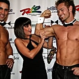 A woman felt the muscles of a Chippendales performer during the 2005 opening night of the performance at The Rio in Las Vegas.