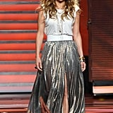 Switching things up a bit, here Jennifer opted for a flashy Lanvin lamé maxi skirt ($4,900) with a Lanvin jersey tee ($520). We loved the contrast between the casual top and the fancy skirt.