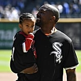 Kanye West and Saint West Throw First Pitch at Baseball Game