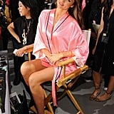 Miranda Kerr showed off her toned legs while sitting in a directors chair before the show.