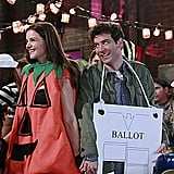 Katie Holmes as Naomi and Josh Radnor as Ted on How I Met Your Mother.  Photo courtesy of CBS
