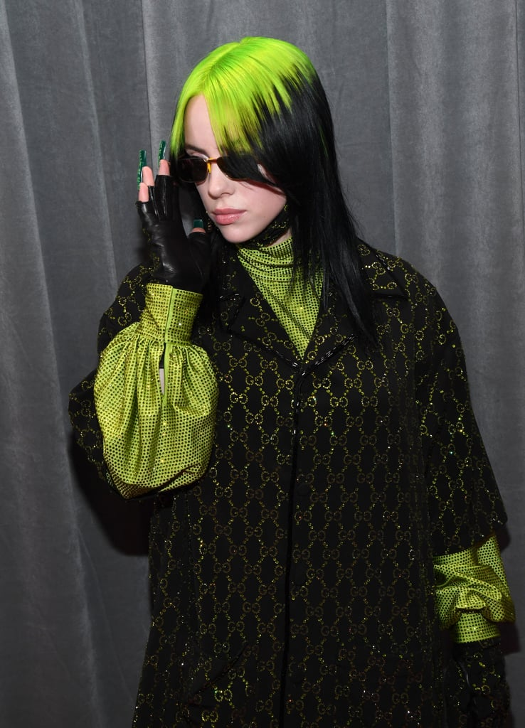 Billie Eilish attended her very first Grammys on Sunday night. The 18-year-old, who made history as the youngest person to receive nominations in all four major categories, sported her signature green hair and a matching outfit as she arrived at the Staples Centre in LA. After waving to her adoring fans outside, Billie once again proved she's one of the coolest teenagers around as she struck a few poses for the cameras. In addition to her nominations for album of the year, record of the year, song of the year, and best new artist, Billie's album When We All Fall Asleep, Where Do We Go? is also up for best pop vocal album and best engineered non-classical album. Needless to say, it's going to be a big night for her. See more pictures of Billie at the Grammys ahead.       Related:                                                                                                           The Musical Style of Billie Eilish: 10 Songs That Tap Into Heavy Emotions and Dark Fantasies