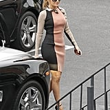 Jennifer Lopez wore a snake-encrusted Lanvin dress on her way to a press conference.