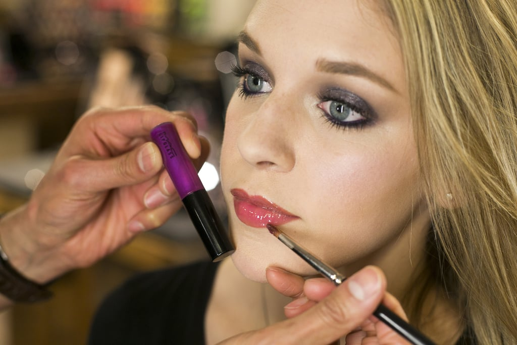 For a glossy, bright lip, apply a vivid purple gloss — try Lipglass in Girl About Town ($15) — to enhance the cool tones featured in the makeup look. The neutral lip base mellows out the intensity of purple in the gloss for a pretty, complexion-enhancing final result.  If you want a less prominent lip to balance your smoky eyes, Jennings also recommends a lighter hue like Wanting More, which can go right on top of your long-lasting lip pencil base.