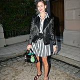 Princess Elisabeth of Thurn and Taxis wearing a belted striped dress and blazer.