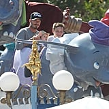 David Beckham enjoyed holding Harper Beckham on his lap with Brooklyn Beckham next to them on a ride at Disneyland.