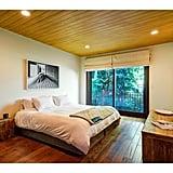 Hardwood floors give all the bedrooms a sleek, modern feel.