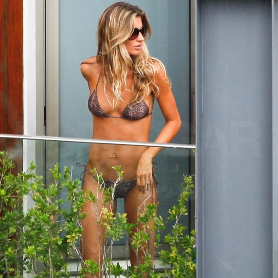 Gisele Bundchen wore a tiny bikini this afternoon while lounging by her hotel's pool in Rio. She and her husband, Tom Brady, arrived in Brazil yesterday, but it was a different male pal who was shirtless keeping her company today. Gisele and Tom are there to have fun during the Carnival festival, after she was there just last month to walk the runway for Colcci during Sao Paulo Fashion Week. Busy Gisele has also had time to hit the gym regularly, and she showed off the results of her hard work in a recent spread for V.