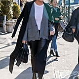 Chrissy was spotted in New York wearing a Haider Ackermann coat with leather pants by The Row. Both her gray cardigan and her handbag were from Balenciaga. She accessorized with Yeezy boots, Céline sunglasses, and jewelry by Svelte Metals.