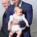 He skillfully held on to George as they arrived at an airport in 2014.