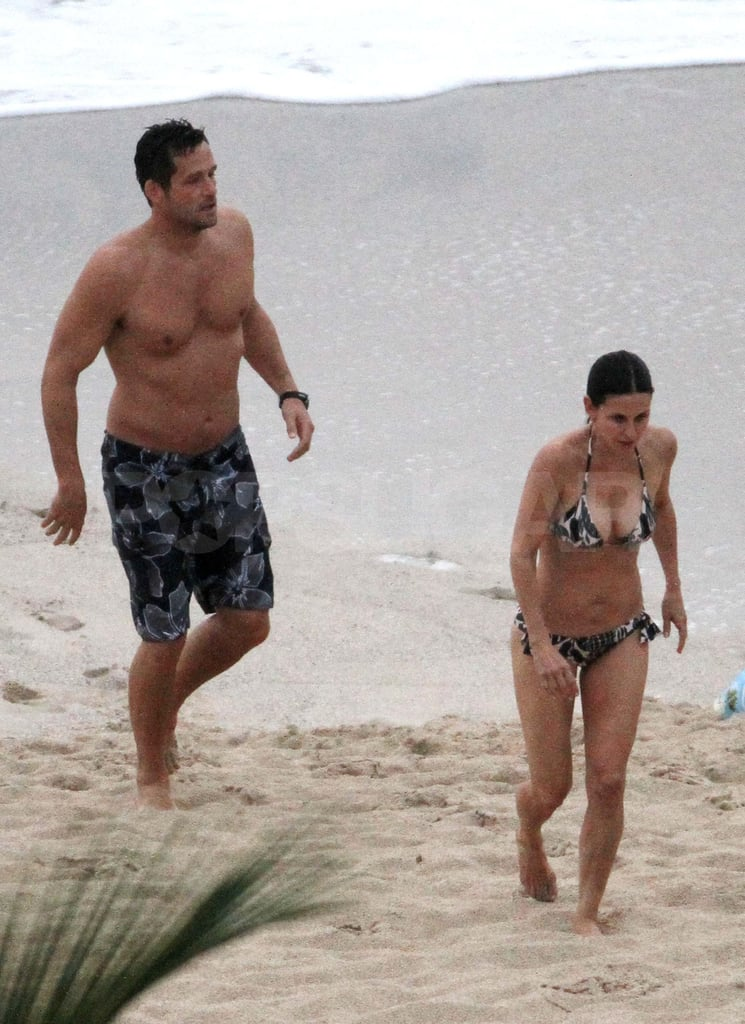 Courteney Cox slipped on a bikini and hit the beach in St. Barts today. She was joined by her Cougar Town costar Josh Hopkins and her daughter, Coco, for a fun day near the water after stepping out in the sand with a friend earlier in the day. The tropical vacation comes after Courteney and Coco spent time together with Josh while filming the series in Hawaii earlier this month. They also shared the sun with Courteney's possible real-life flame, Brian Van Holt, during their stay on the islands. Courteney and Brian may or may not be an item, since she seems to still be in limbo with her estranged husband, David Arquette. She shared sweet words about him while doing press for Scream 4, which has most of you convinced things are not over between the two. They'll be in the spotlight together again soon when they hit the red carpet to show off their thriller, and starting tomorrow we'll need your help choosing which lucky I'm a Huge Fan finalist will get to interview them at the premiere!