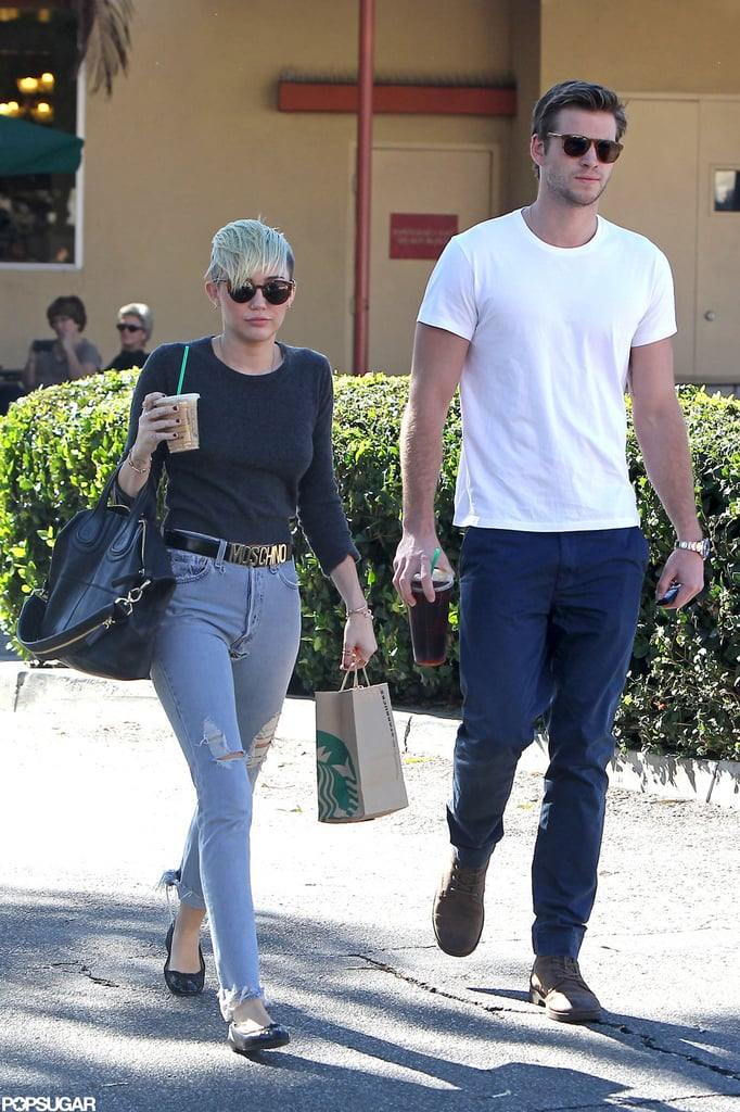 Miley Cyrus and Liam Hemsworth stopped for Starbucks together in LA today, with Miley wearing her favorite Moschino belt. Liam and Miley aren't the only ones who enjoy their coffee —earlier this week, Miley shared a photo of her pup Lila enjoying Starbucks, too! Miley and Liam have been able to spend a great deal of time together despite their various work commitments. Liam's been shooting Catching Fire, while Miley had her own filming to do. She promoted her cameo on Two and a Half Men last week with stops by both The Tonight Show and Chelsea Lately.