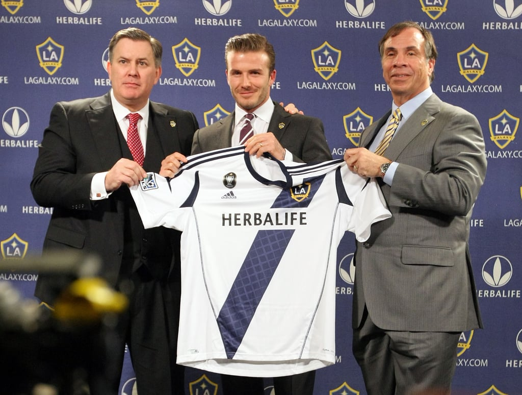 Beckham posed with his navy, white, and gold jersey.
