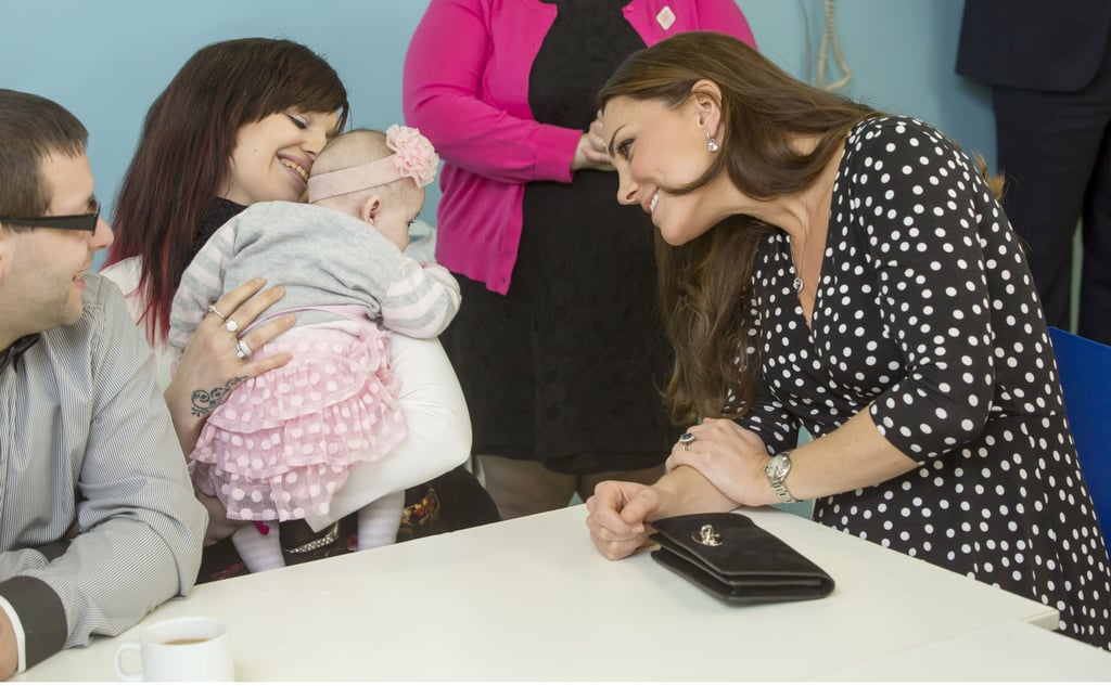 Kate cocked her head to smile at a baby girl during a visit to the Brookhill Children's Centre in London in March 2015.