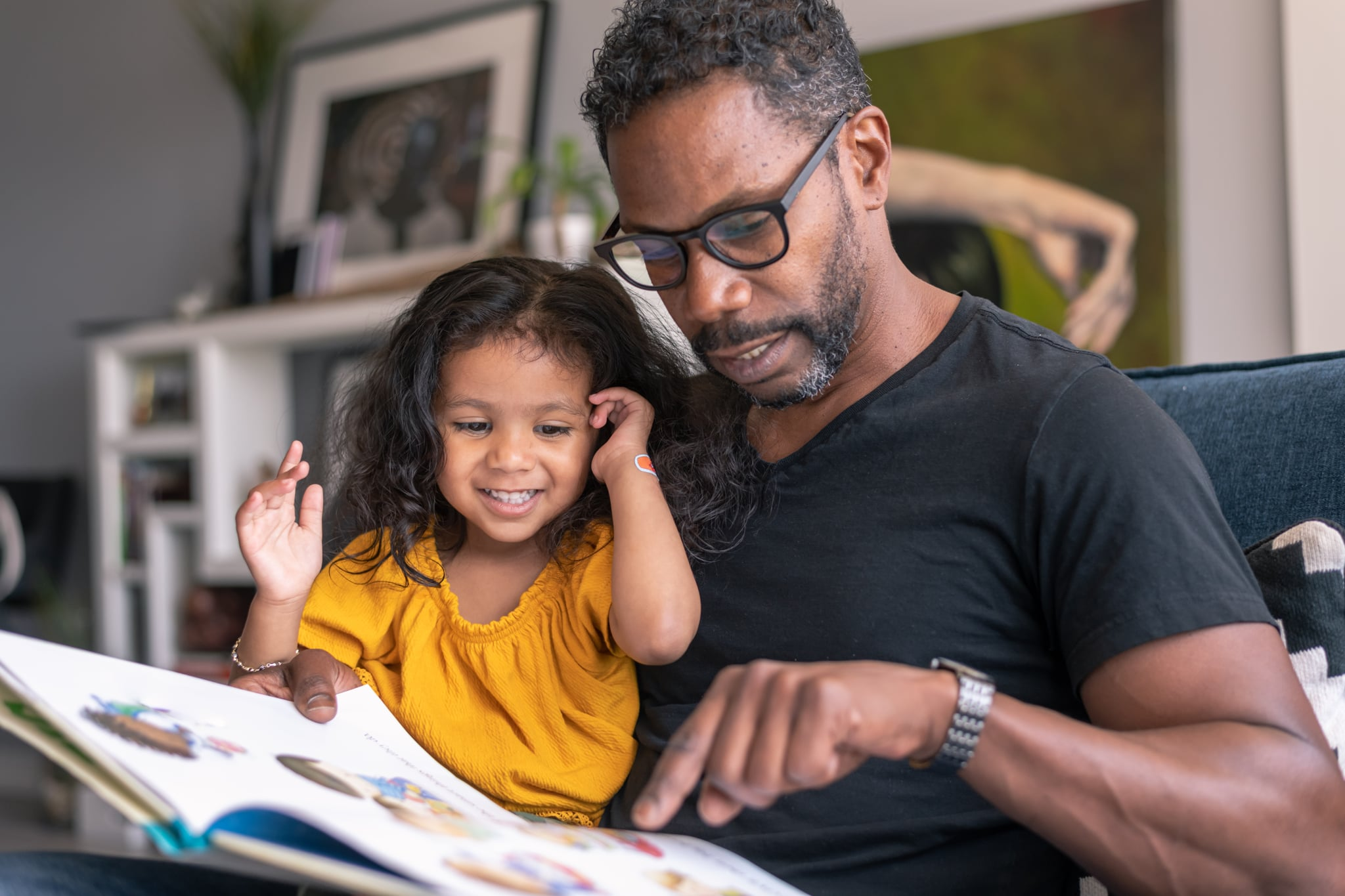 Father and daughter read together.