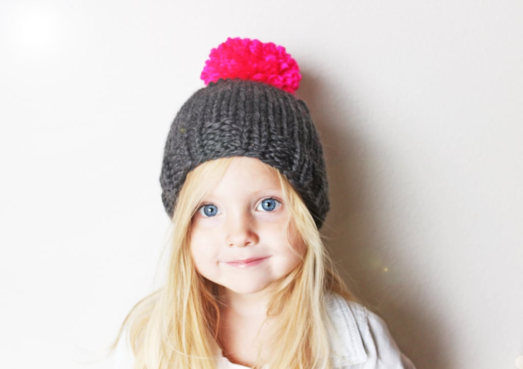 This knit pom pom beanie ($18) will add a pop of color to any outfit.