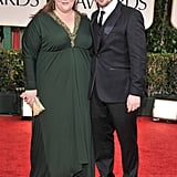 We're green with envy over this forest green number — and how cute Melissa looks with her husband, Ben Falcone.