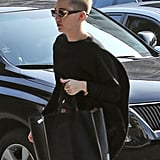 Miley Cyrus wore a black sweater.