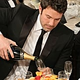 Ben Affleck poured himself some Champagne during the ceremony. . Source: Christopher Polk/NBC/NBCU Photo Bank/NBC