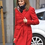 Queen Letizia rocked a bright red coat while out and about in January.