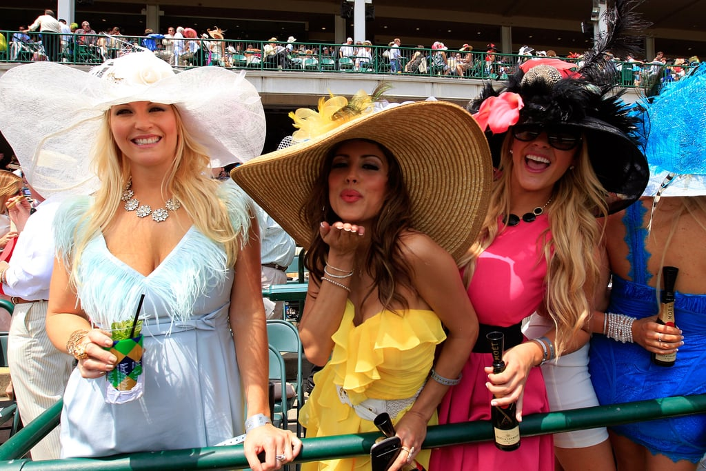 Three women showed off their large hats in 2012.