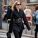 Black on black is anything but boring when an oversized buckle in sleek gold is part of the equation.