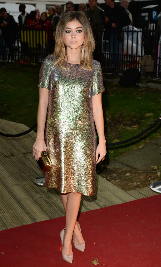 Sarah wore a glittering gold dress.