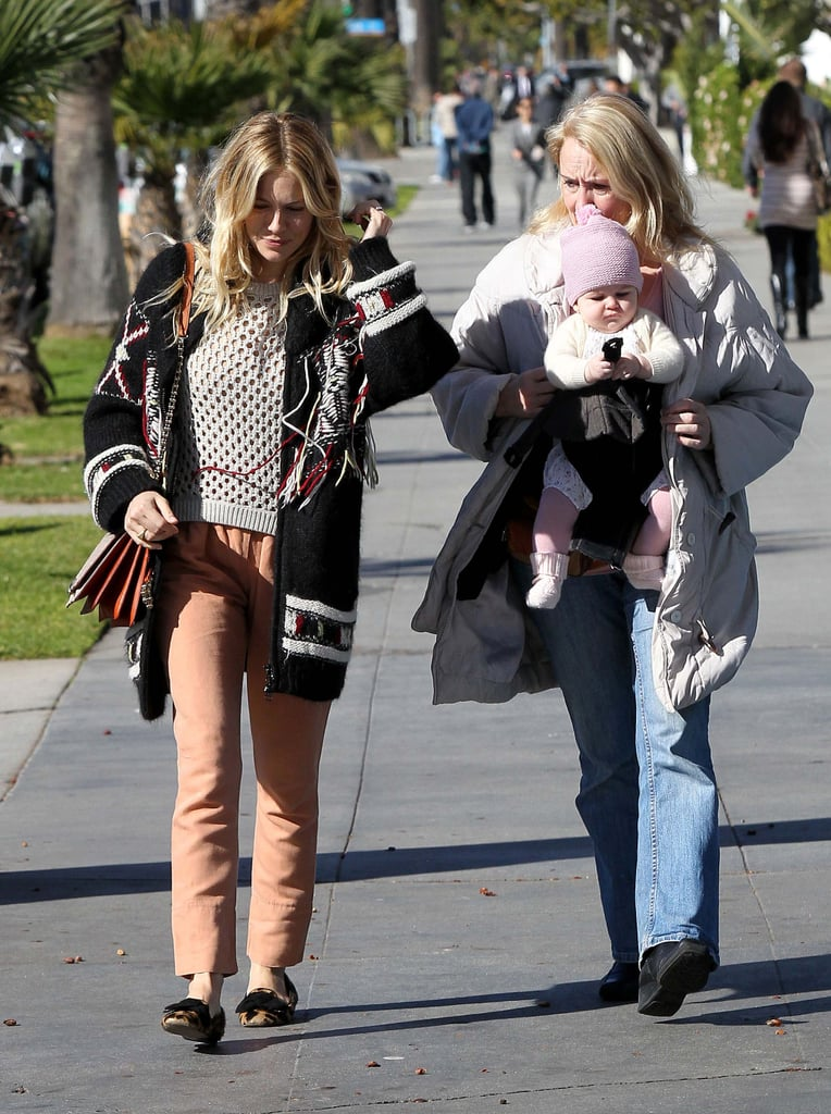 While spending time with her daughter and mom in LA, Sienna donned an eclectic mix of orange pants, a crochet sweater, and a knit cardigan, then finished with her leopard loafers.