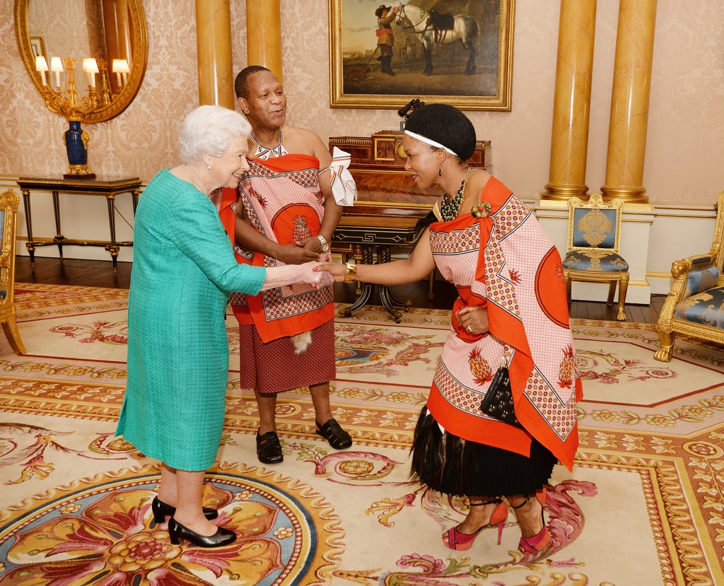 Queen Elizabeth II greeted Mrs. Nkambule, the wife of Mr. Christian Muzie Nkambule the High Commissioner of Swaziland, after he presented his Letters of Credence at the Buckingham Palace in March.