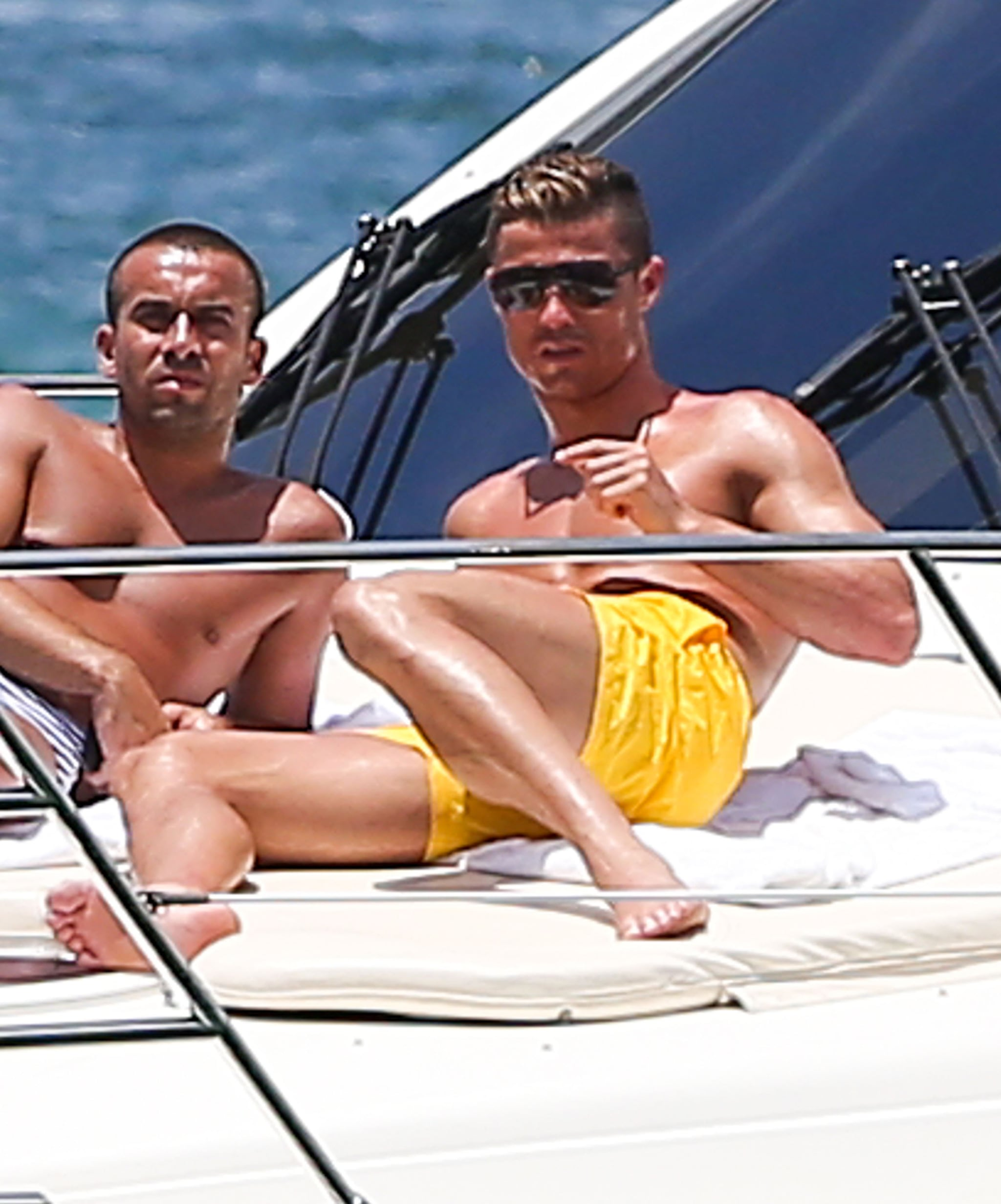 Cristiano Ronaldo chilled out shirtless on a Miami yacht with a friend in June.