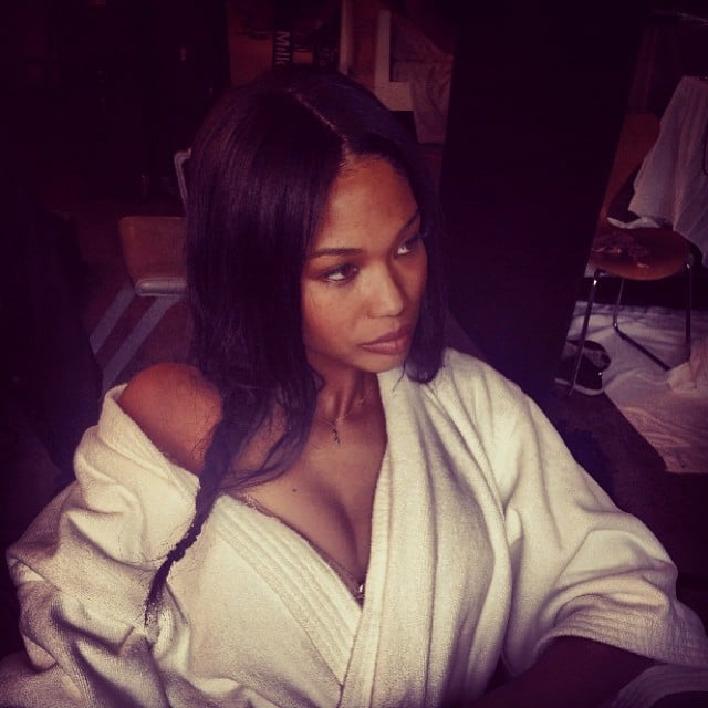 Chanel Iman curled up in a comfy robe on set. Source: Instagram user chaneliman