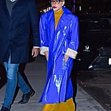 She wore this electric blue trench coat for a date night with her fiancé Christian Carino.