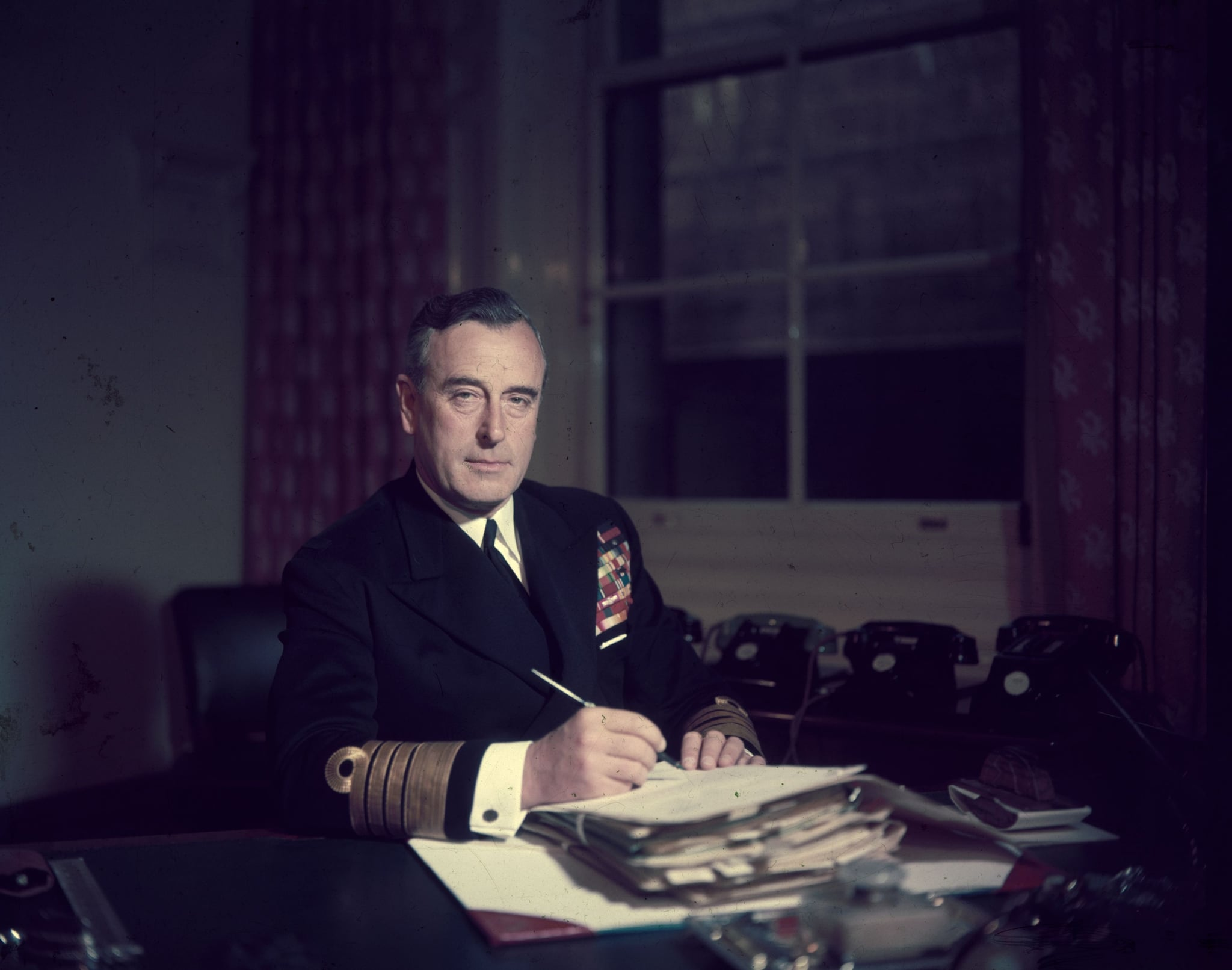 22nd April 1955:  First Sea Lord Louis Mountbatten, Earl Mountbatten, at his office in the Admiralty.  (Photo by Hulton Archive/Getty Images)