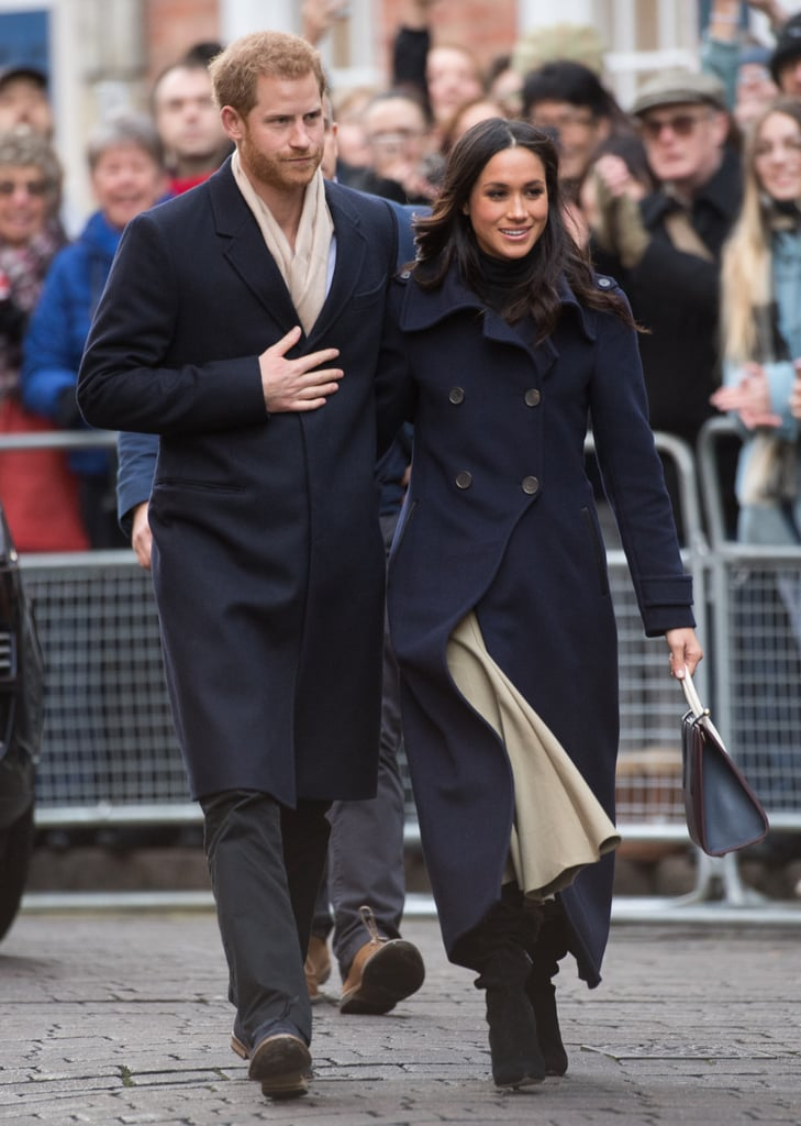For Meghan's first royal engagement, she accompanied Prince Harry for a visit to Nottingham. Meghan  matched her beau in a navy Mackage coat, but the real star of the show was her Strathberry Midi Tote ($675). According to a press release from the brand, it sold out in 11 minutes and was listed for up to almost four times its retail price on eBay.