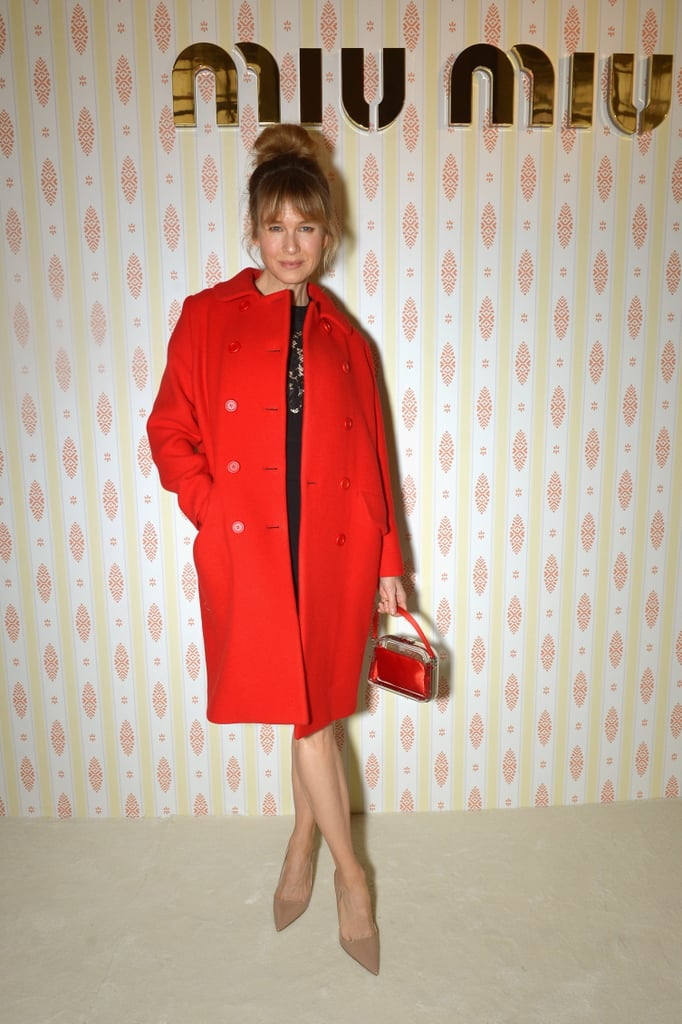 """Renée Zellweger made a stylish appearance at Paris Fashion Week on Wednesday, sporting a chic red coat and showing off her new bangs as she posed for pictures. The event marked Renée's first public appearance since she made headlines last Autumn for looking a little different at the Elle Women in Hollywood Awards. At the time, some people speculated about plastic surgery, while others just wanted everyone to leave her alone. The buzz prompted Renée to talk about her changing looks, as she told People that she looked different because she was happier than ever. She said, """"I'm glad folks think I look different! I'm living a different, happy, more fulfilling life, and I'm thrilled that perhaps it shows."""" Keep reading to see more pictures of Renée's latest appearance, then see all the celebrities at Paris Fashion Week!"""